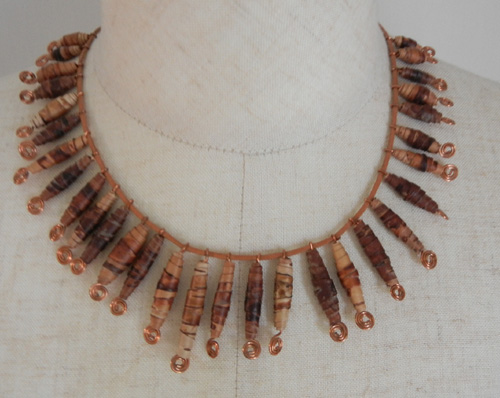 Birch bark necklace sold beads of birch bark and copper on a strip of